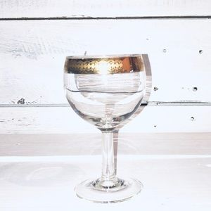 Antique wine glass with gold inlay